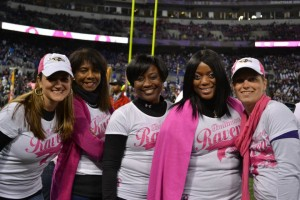 Trish in a close up shot with other warriors on the field