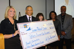 Ginny Goddard (co-chair Get Your Rear in Gear - Kansas City), John Bluford (President/CEO, Truman Medical Center), Kari Lorenzen (co-chair Get Your Rear in Gear - Kansas City), Teresa White (wife of Frank White) and Frank White during a check presentation at the Colon Cancer Awareness Month event at Truman Medical Center.