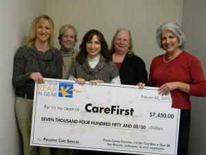 Pictured from left, CareFirst social worker Stacey Jerzak, LMSW; CareFirst Palliative Care nurse Kate Hembrooke, RN; Get Your Rear In Gear event coordinator Donna Marrone; CareFirst CEO Mary Ann Starbuck; Colon Cancer Coalition champion Lori Spallone pose for a picture during the check presentation.