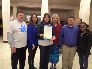 Nikol and other colorectal cancer advocates with March 2015 proclamation