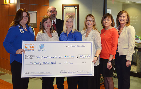 Get Your Rear in Gear - Wichita presents check to Via Christie
