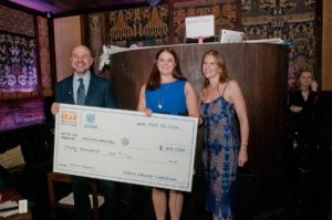 Erin Peterson from the Colon Cancer Coalition presents David and Robin Dubin with a check for the Heroic Registery