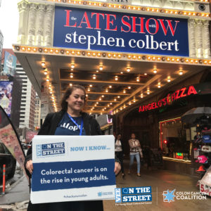 Vanessa holding sign outside The Late Show with Stephen Colbert.