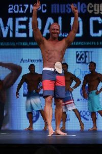 Doug on stage at a bodybuilding competition.