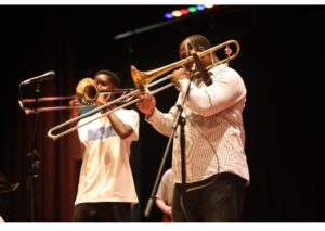 Paulie playing trombone.