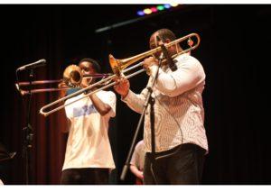 Paulie playing trombone.
