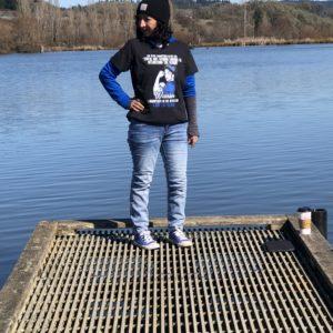 Amber posing by lake.