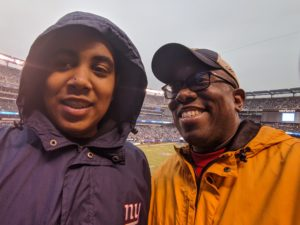 Rodnell and son at Giants game